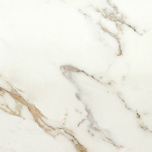 Calacatta Gold  Calacatta Gold will have a creamy white background with light grey veins and a mix of gold. Perfect kitchen counter top.