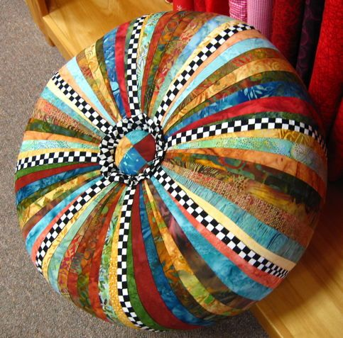 Tuffet using neutral batiks mixed with bold, black and white checkered fabric.