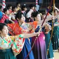 Time's arrow. Women reaching the age of majority (20) on Coming-of-Age day practising the ancient art of kyudo (archery)