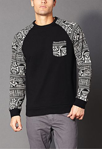 A raglan sweatshirt featuring a tribal print. Crew neck. Patch chest pocket. Long sleeves. Ribbed trim. Knit. Light to medium weight.