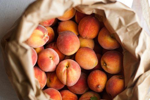 Peaches in a paper bag