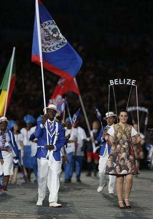Belize's flag bearer Kenneth Medwood holds the national flag as he leads the contingent in the athletes parade during the opening ceremony of the London 2012 Olympic Games at the Olympic Stadium July 27, 2012.