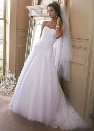 Classic silhouette meets modern design in this beautiful sequin tulle wedding dress!