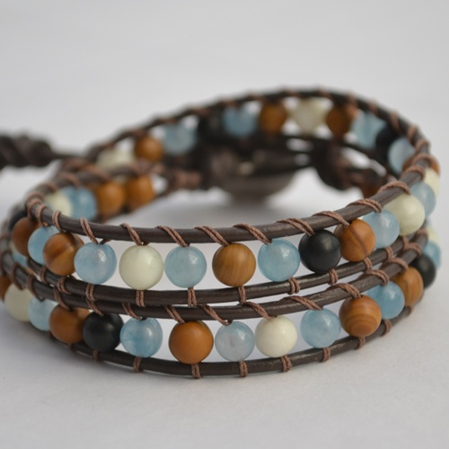 HB Healer double wrap bracelet is designed with a beautiful combination of Larimar, Mother of Pearl and Black Tourmaline Gemstones. Created to bring inspiration and harmony to your life, promoting healing from within and without. On chocolate brown genuine leather, finished with a unique pewter button clasp.