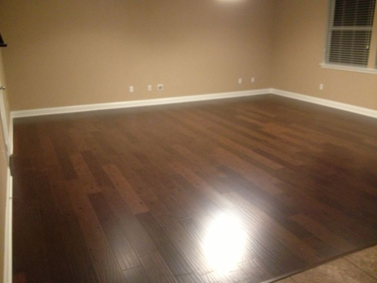 Mohawk laminate wood floor. Love the floor and wall color.