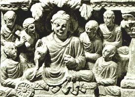 The wheel in this picture represents the law. It is called Vajrapani and First Five Disciples Listen to the First Sermon. He is sitting under a different tree to consider what he had understood and the bliss it produced.