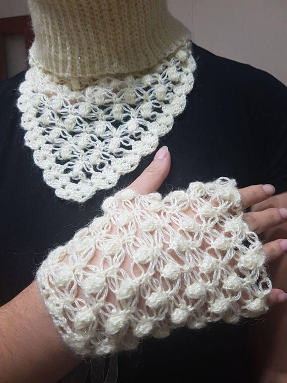 This hand crocheted, eye-catching, warm and fuzzy neck warmer would make a perfect gift for any woman! It has been crocheted in a wonderfully fun bulky yarn in a lovely shade of cream. This is a pull over style cowl that allows for some versatile looks. Eye-catching, warm and fuzzy