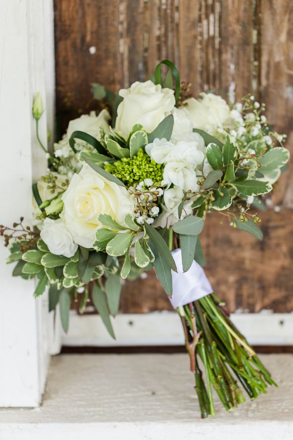 Elegant white and green bouquet. View the full wedding here: http://thedailywedding.com/2016/06/27/dazzling-rustic-barn-wedding-alyssa-josh/