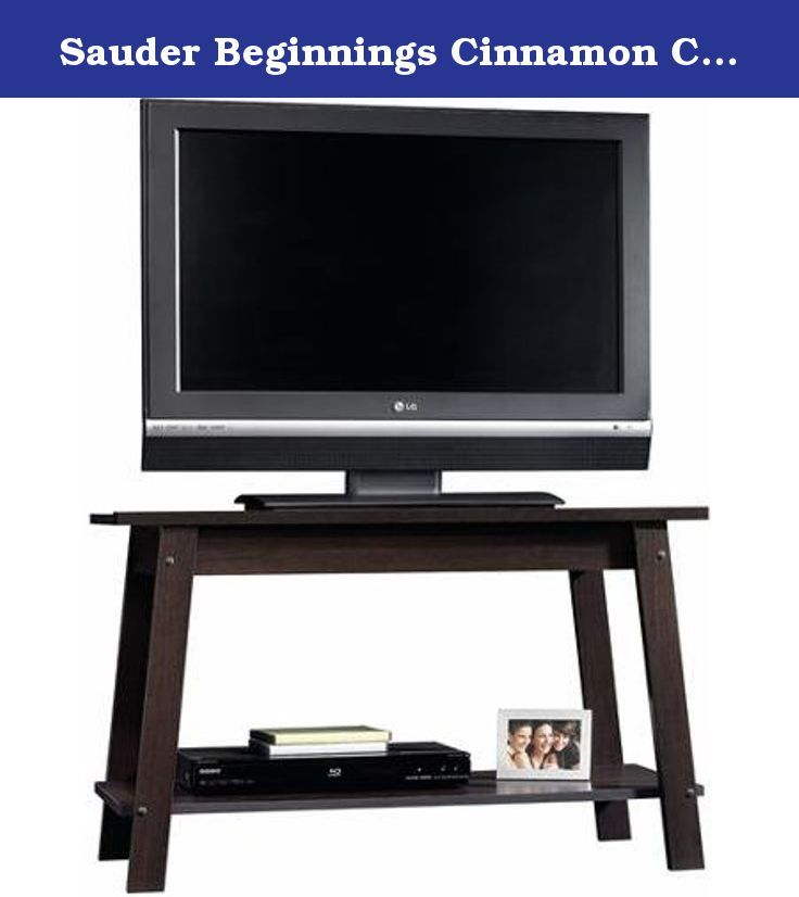 "Sauder Beginnings Cinnamon Cherry TV stand for TVs up to 37"" Modern Style. Add modern style to your room with the Sauder Beginnings Cinnamon Cherry TV Stand. This stand is made from engineered wood with a cinnamon cherry finish and features a shelf for storing your audio and video equipment. This Sauder TV stand is designed for TVs up to 37"", and it is suitable for flat panel TVs."