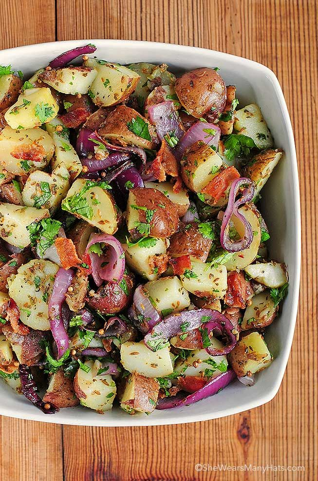 Crispy bacon, grilled onions, and zesty spices give this potato salad a Texas twist. Get the recipe from She Wears Many Hats.   - Delish.com