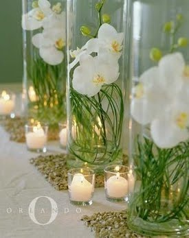I love the Orchids inside the glass like this!