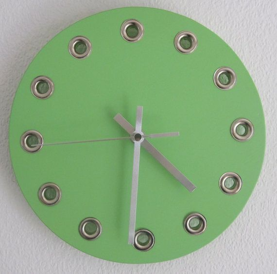 A unique and colourful handmade and hand painted eyelet clock by TimeAndDesign, £15.00 Find it on: https://www.etsy.com/uk/listing/195577620/a-unique-and-colourful-handmade-and-hand?ref=shop_home_active_3