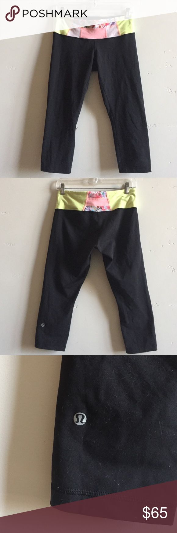 Lululemon Reversible Wunder Under Crops Lululemon reversible Wunder Under black crops.  One side is all black and the other is black with a pink/ yellow floral band. Very light pilling in crotch area on floral band side.  Never worn on all black side (rip tag is still attached). In excellent condition. lululemon athletica Pants Ankle & Cropped