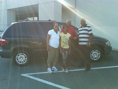 Folger Subaru Sales Consultant Bill Barber with the Banner family and their 2007 Dodge Caravan!