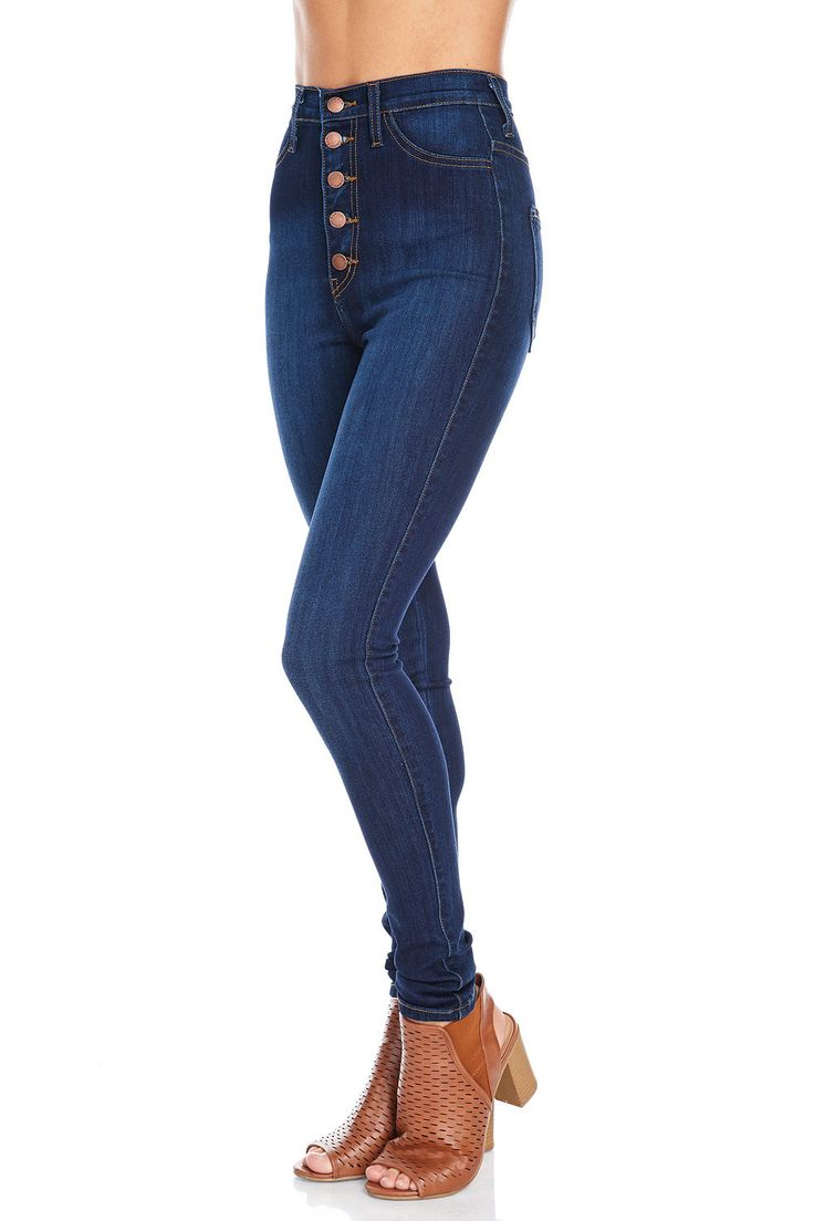 Super high waist skinny jeans with faux pockets at the front and open pockets at the back. Stacked button- fly closure. Super stretchy denim with a soft comfortable fit. Dress it up with a basic crop