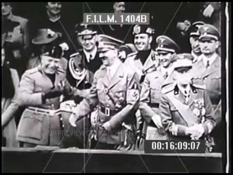 WWII Italian troops march by reviewing stands of Hitler Mussolini