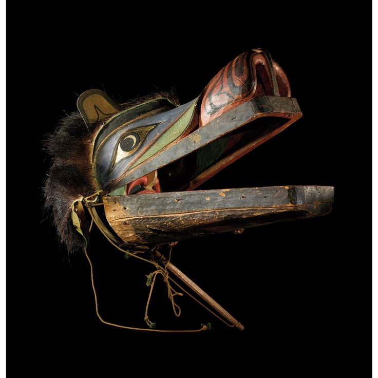 A Kwakiutl transformation mask, British Columbia, Northwest Coast  Composed of articulated components which the wearer moves by using a set of strings, the transformation mask is a perfect illustration of 'thepower to disconcert the mind, which the Surrealists sought'(Walberg, 1965: 20). Here, the bear's head opens all along its lengh, allowing one to see a previously hidden human face, demonstrating to the onlooker the metamorphosis of one being into another.