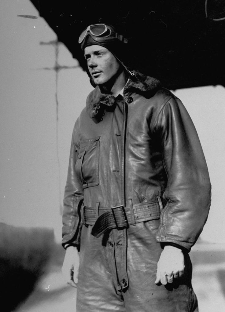 Aviator Charles Lindbergh poses for a photo in a leather flight suit.