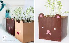 Macetas de tetrabrick con carita en Manualidades infantiles para bebés, niños y niñas