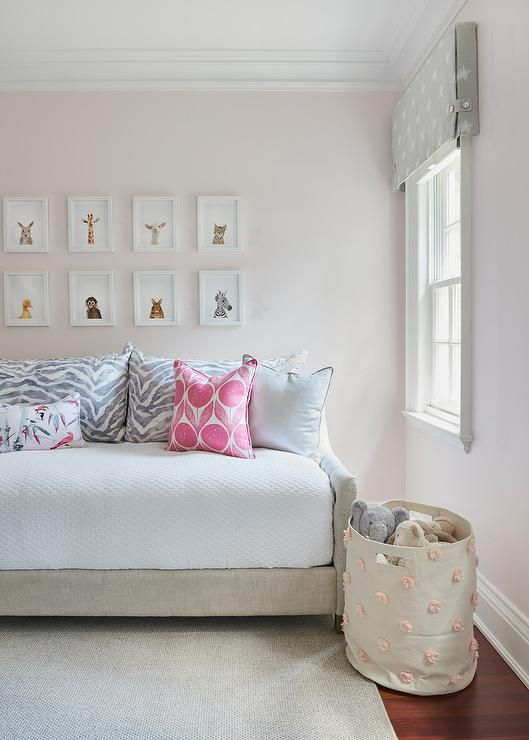 Galery style display made up of: The Animal Print Shop Baby Animal Prints over an RH Teen Devyn Tufted Daybed.