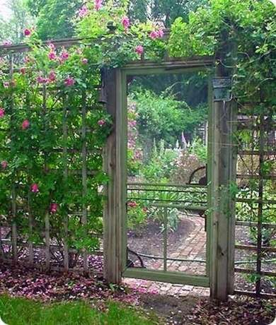 A salvaged screen door provides a fitting, friendly entrance for this beautiful country garden. Unlike its solid wood counterpart, a screened door offers visitors a sneak peak and can withstand winds without issue.
