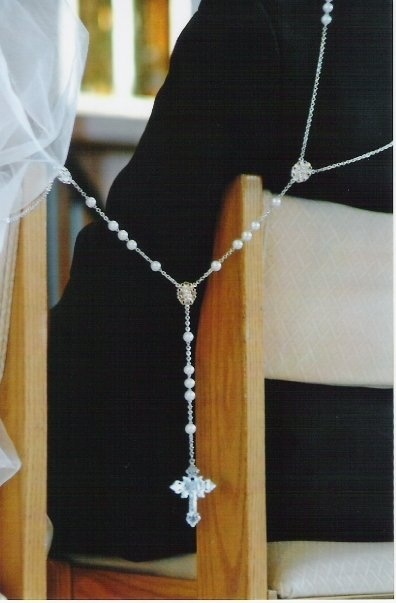 Rosary wedding lasso - Latino Catholic Tradition for ceremony.  http://www.catholiccompany.com/wedding-lasso-rosary-pearl-beads-silver-chain-i30786/?sli=2011987