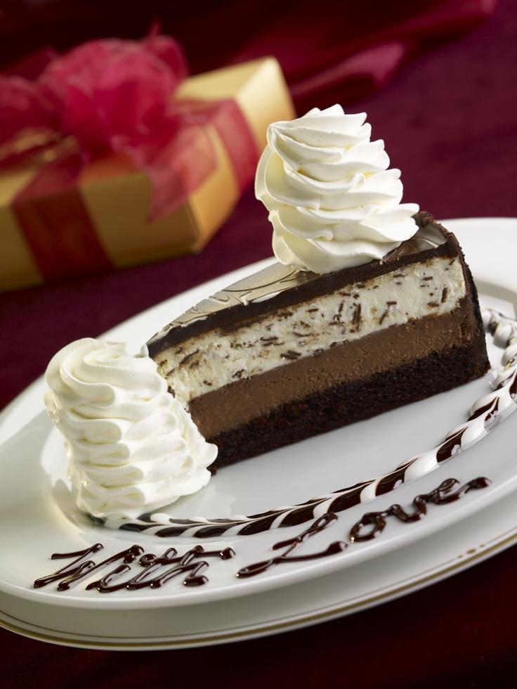 Chocolate Tuxedo Cream™ Cheesecake: Layers of moist fudge cake, chocolate cheesecake, vanilla mascarpone mousse and chocolate.