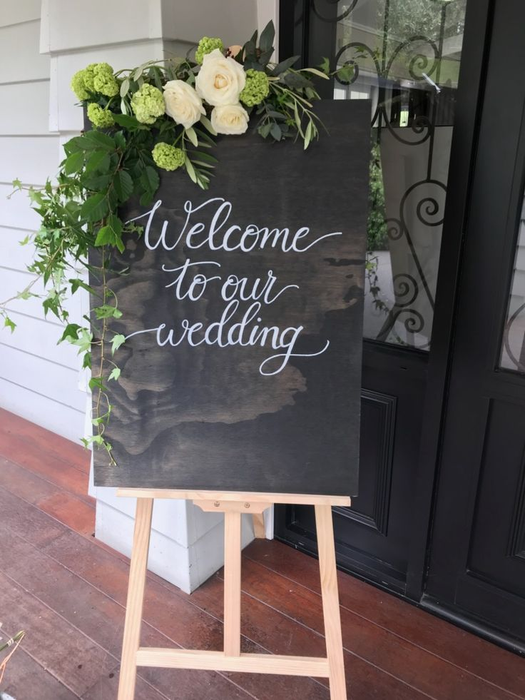 Welcome to our wedding. Signage to welcome your guests in style. White hand written calligraphy on black hand stained wood.