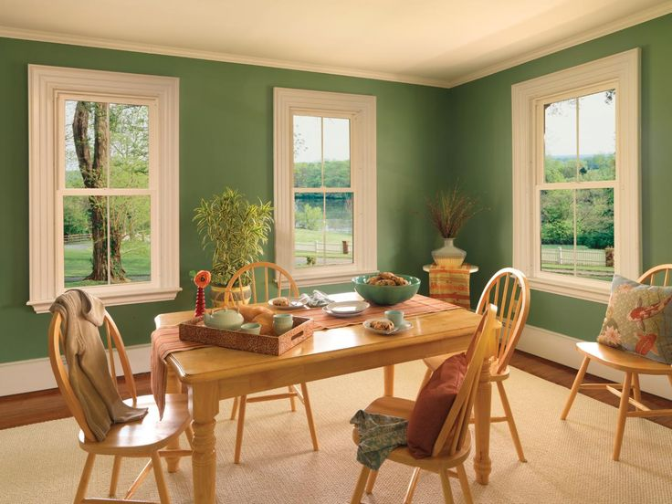 This green  country style dining area features gorgeous painted wooden molding Potted Living Room 51 best living room paint colors images on Pinterest Cozy
