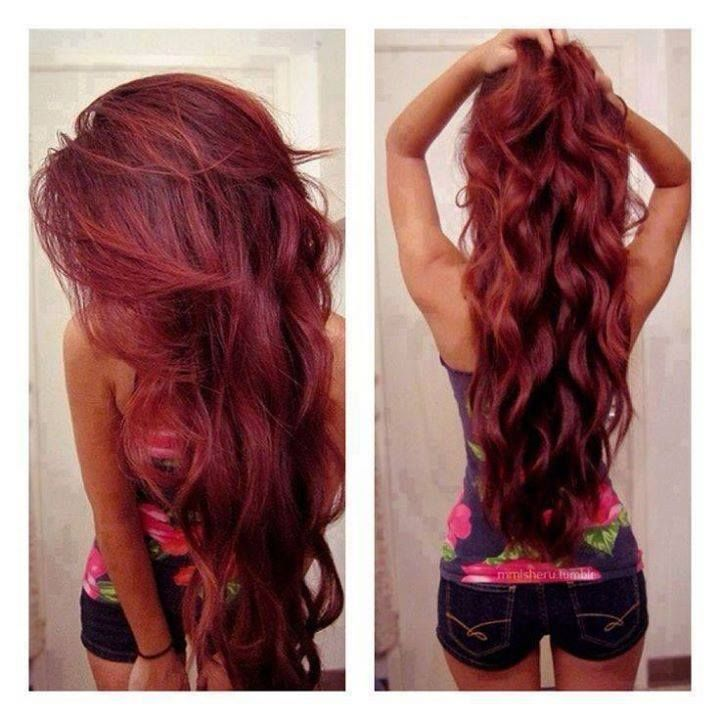burgundy curly hairstyle. red hair curls