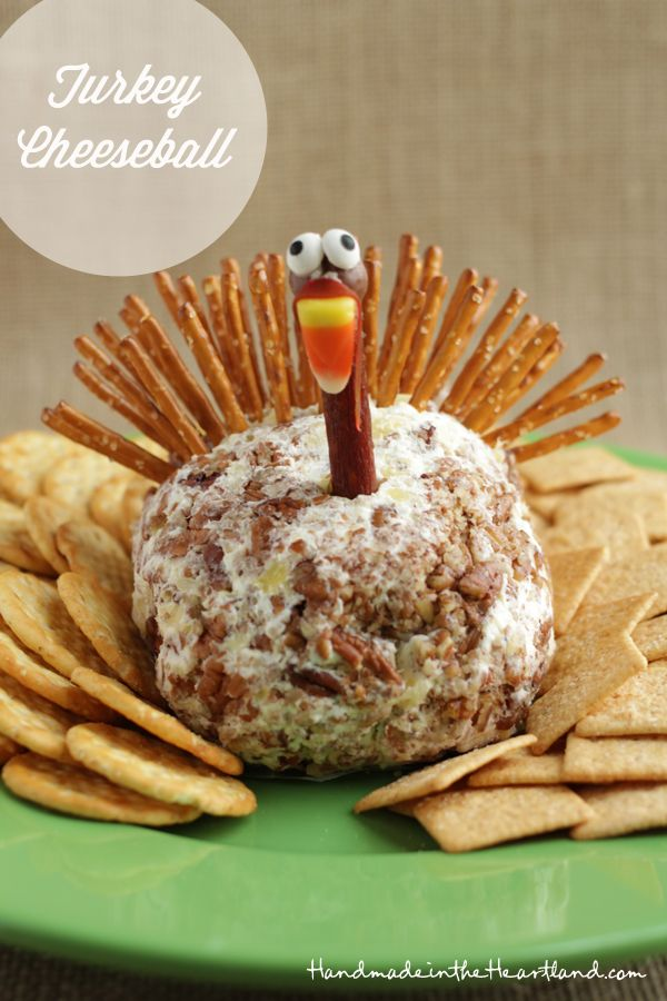 Thanksgiving Cheeseball • 2 8oz pkgs of cream cheese, softened 2 Tbls minced onion ½ tbls minced green bell pepper 1 8oz can crushed pineapple drained 1 tsp salt ½ tsp garlic powder ½ tsp onion powder 1 c chopped pecans decorations: pretzel sticks whopper candy beef jerkey stick candy eyes candy corn fruit roll up chocolate icing or melted chocolate