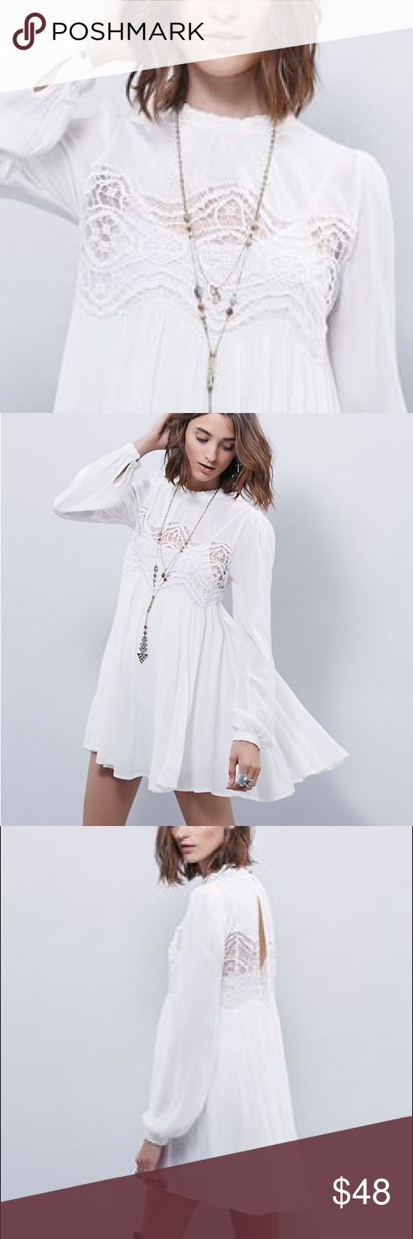 """Crepe Crochet Tunic DRESS Sweet Thing White NEW BRAND NEW!! Semi-sheer printed crinkly crepe babydoll tunic with lace trims at mock neck and cuffs. Sheer crochet lace contrast and large back cutout with button closure at nape.  S: Bust: 32.8""""/Length: 30.9"""" M: Bust: 33.8""""/Length: 31.4"""" L: Bust: 35.4""""/Length: 31.8"""" XL: Bust: 37.1""""/Length: 32.4""""  🌟🌟Item is Brand New, direct from the Manufacturer, & Sealed in Pkg. 🌟🌟 austin gal Dresses"""