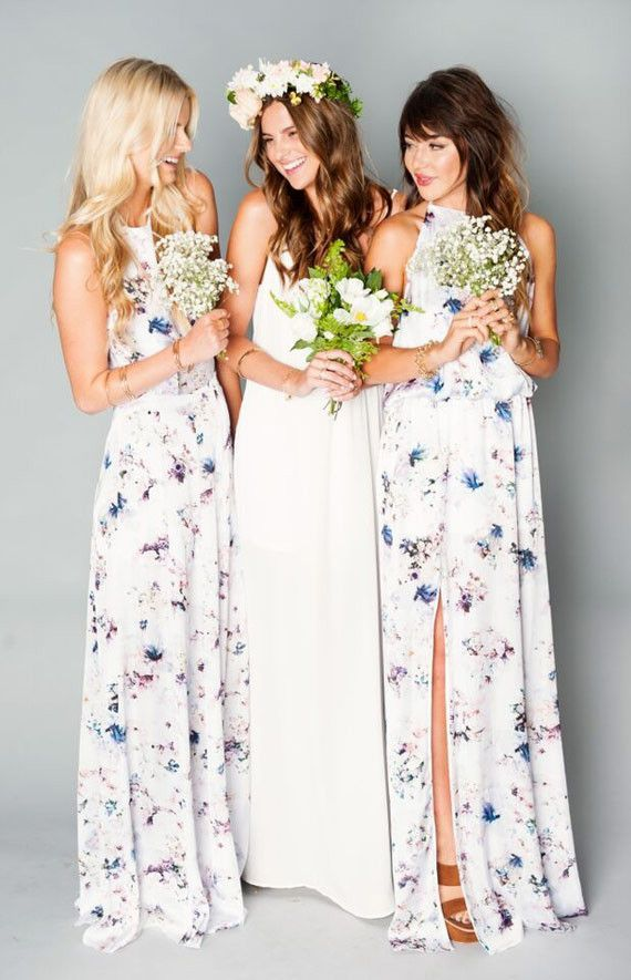 A dress your bridesmaids might actually use again! These floral printed dresses are such a cute alternative to solid dresses. This style would look perfect with your boho themed wedding, especially with the simple bouquets and curled hair paired with the dresses.