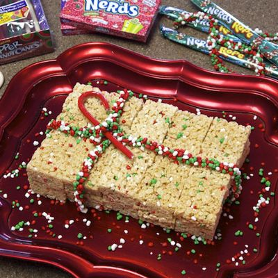 Nerds Crispy Rice Cereal Treats | SimplyCelebrate.Meals.com - NERDS mixed into these crispy rice cereal treats are sweet enough - add the NERDS Rope bow for the gifting season! #simplycelebrate