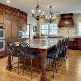 Traditional, Transitional, Modern Kitchen Remodel with Grand Sized Kitchen Island and Wood Hood in Dark Cabinetry