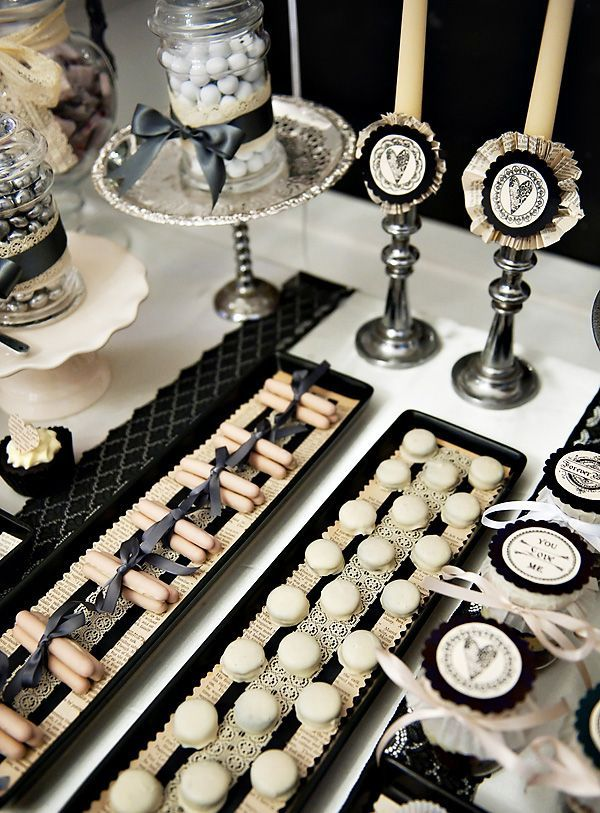 """I created this Dessert Table for a Gothic inspired Wedding Event that took place in The Wedding House in Liverpool City, England. The Creative Brief was ""an alternative Gothic Dessert Table"".I chose a dark color palette, but I did not want it to be over whelmed with black as I though that would be too gloomy. I used, grey, cream and off-white to perk things up a bit and silver was used to add light to the table.I used pages from old books as tray liners and used lace and ribbon to dress up…"