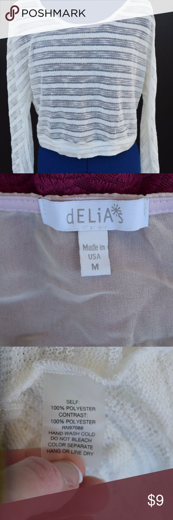 Delias Womens Long Sleeve Cream Shirt - MED Brand: Delia's Gender: Women's Item: Shirt Color:  Cream Size: Women's Medium Neckline:  Boat Neck Sleeve Length: Long Sleeve Materials:  100% Polyester Additional Info:  Solid Contrast Piece Down the Middle of the Back Under Arm to Under Arm Measurement: 22.5 Inches Length: 17 Inches Condition: Gently Pre-Owned, Good Condition Delia's Tops