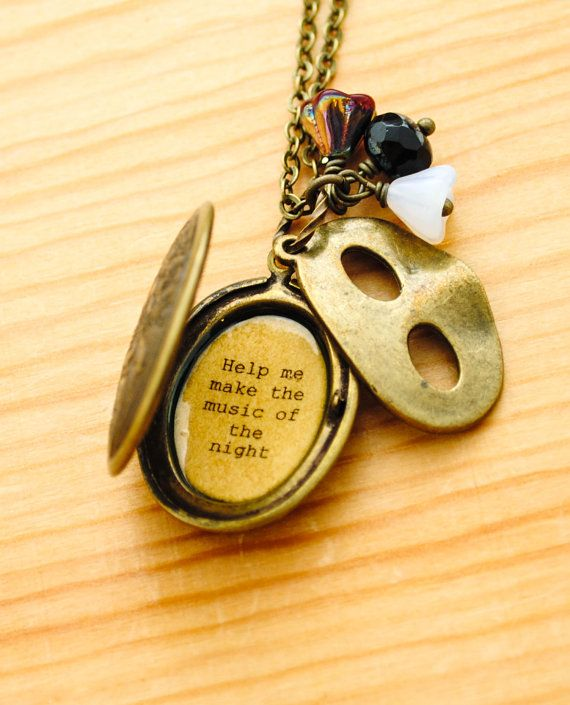 Inside the locket is a hidden a lyric from Music of the Night from Andrew Lloyd Webbers Phantom of the Opera, You alone can make my song take