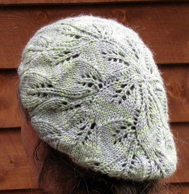 Very pretty. Ravelry: Leafy Rosette Beret pattern by Amy Jansen