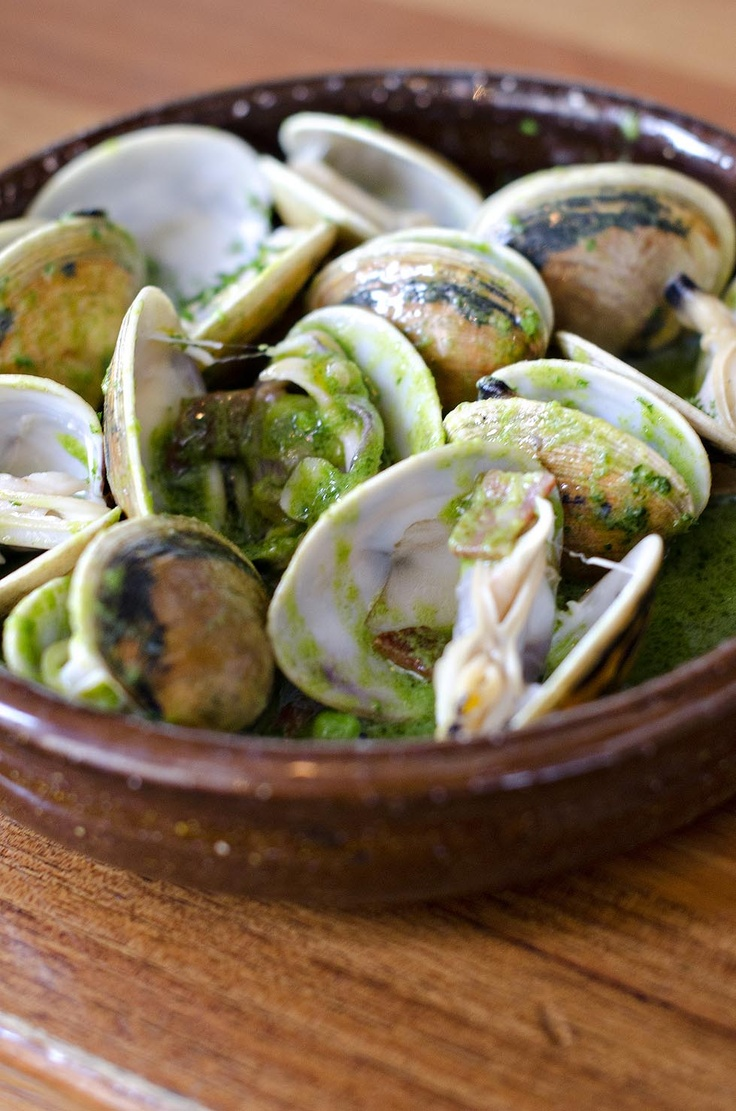 Almejas: Clams in green basque sauce with jamon and peas.