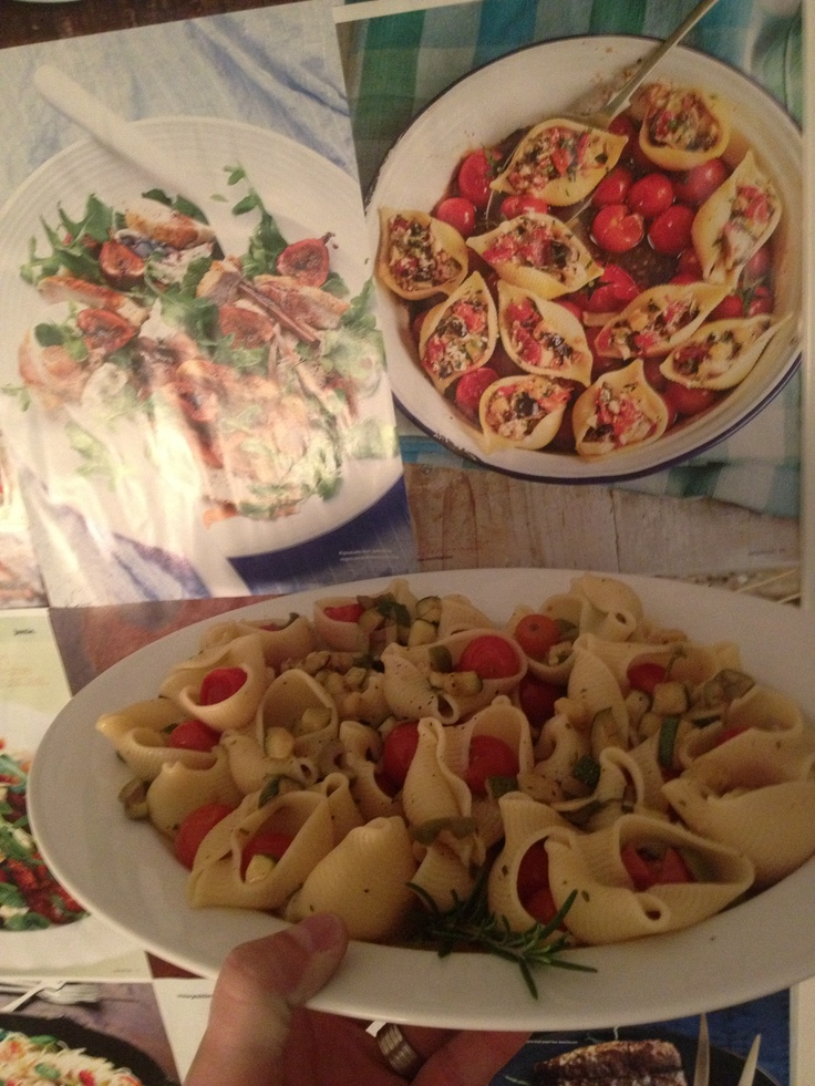 Conchiglioni with cherry tomatoes and olives.