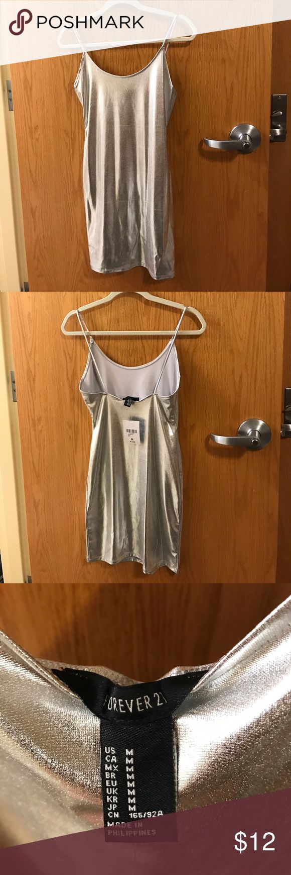NWT Forever 21 Metallic Cami Dress Brand new with tags Forever 21 silver cami dress! Super simple dress, very shiny. True to size. Has a good stretch to it as well, very fun and flattering! Forever 21 Dresses Mini