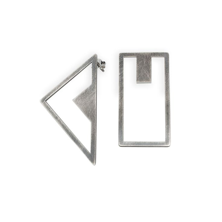 """Geometricearringsfrom NOILENCE's Luminous collection.  Materials:Oxidized sterling silver with sterling silver ear wires and ear nuts  Measurements:Triangle-- 5 cm x 2.5 cm (2"""" x 1""""), Orthogon-- 4 cm x 2 cm (1.6"""" x 0.8"""")  Designed in: Greece  Crafted in: Greece"""