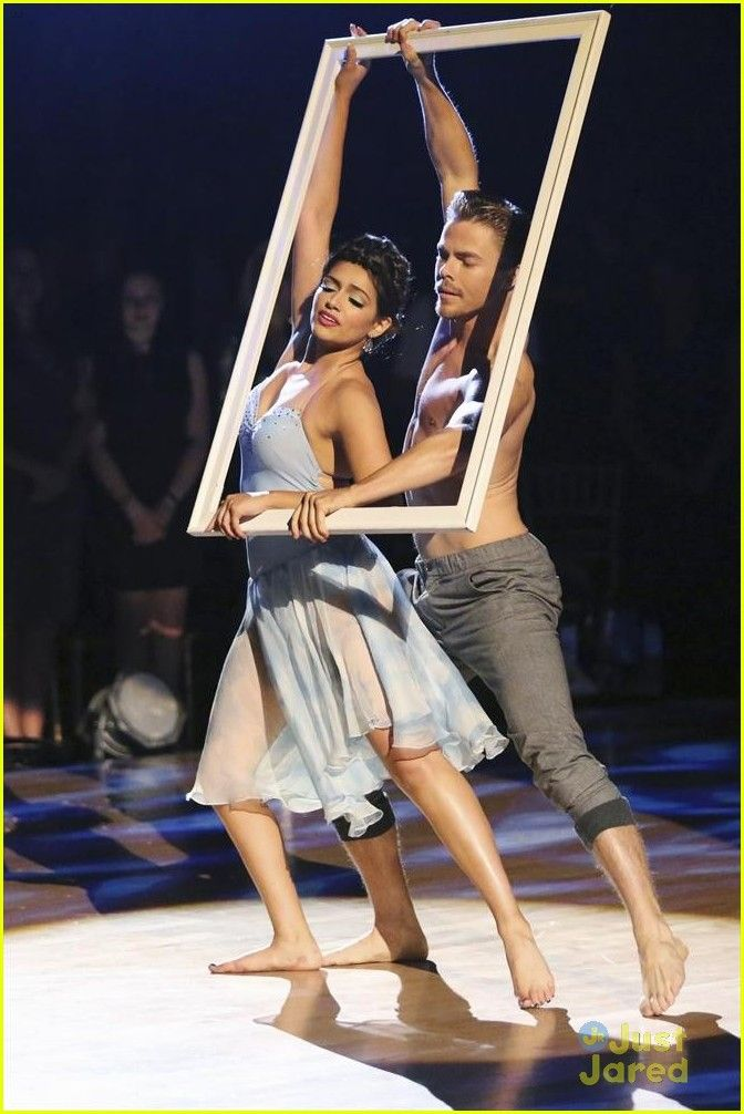 Bethany Mota and her shirtless pro partner Derek Hough dance with a picture frame on Dancing with the Stars on Monday night (November 17)
