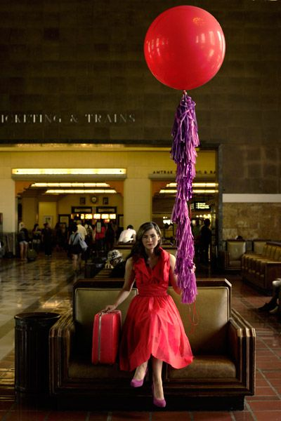 Retro clothes, an old-fashioned suitcase, big ol' balloon (Geronimo Balloon Company) and a ... train(?) station.