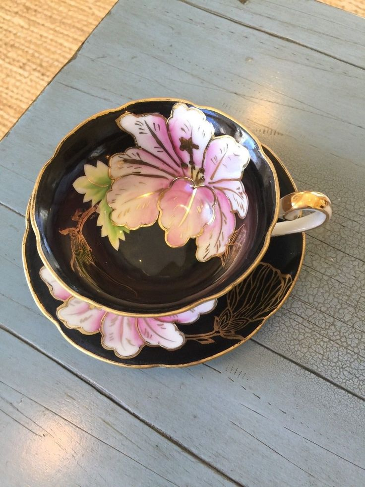 TRIMONT Tea Cup and Saucer Made In Occupied Japan Black & Pink Floral Footed - CAD $19.44. This listing is for a beautiful teacup and saucer made in Occupied Japan by Trimont. The cup has pretty floral and gold designs. The flowers on this one appear to be lilies. The footed cup measures 2 1/4 inches tall, and the saucer is 5 1/4 inches across. The set is in very good, vintage condition with no chips or cracks. Please see my other teacup listings. Thank you! 232680905303