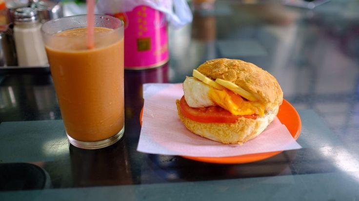 Pineapple bun burger and ice milk tea at 華嫂冰室   #tea #milktea #icedtea #pineapplebun #hongkong #yelpeatshk #hkeats #hongkongfood #eggbun