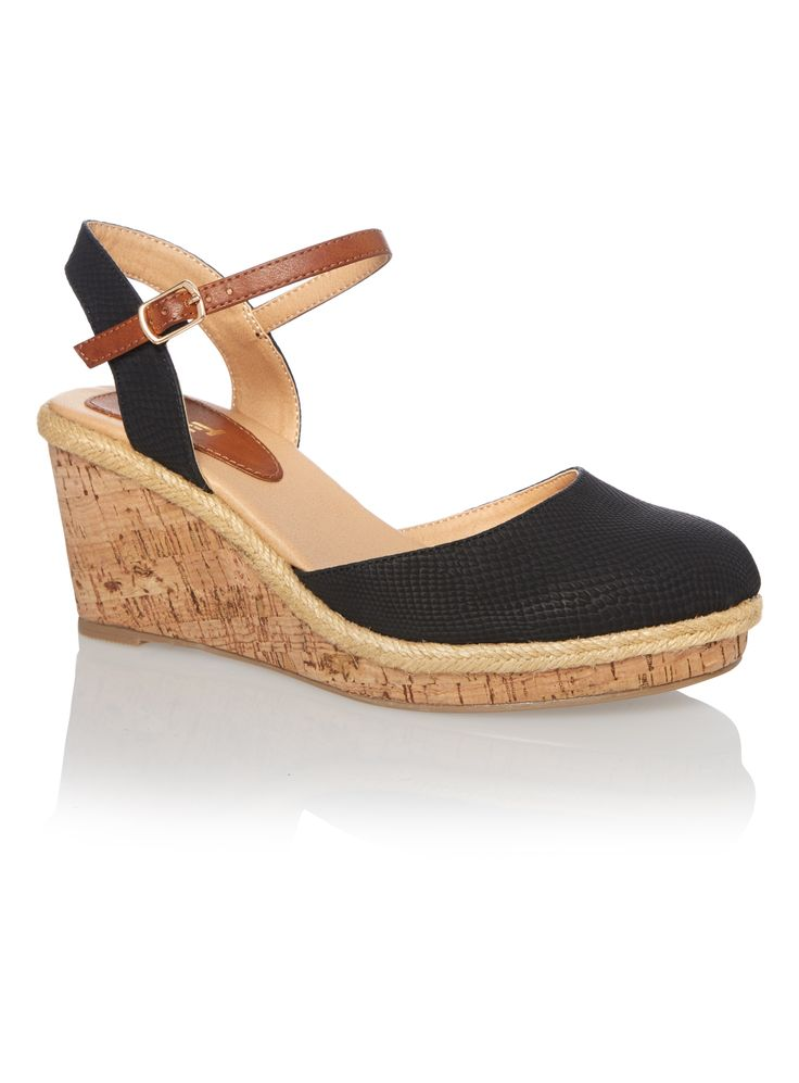 Take your look from office to dinner with these stylish wedge sandals. In black, these sandals are designed with a snake print upper with buckled ankle straps and raffia soles. </p><ul><li>Black cork wedge sandals</li><li>Snake print upper</li><li>Buckled ankle strap fastening</li><li>Almond toe</li></ul>