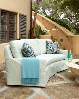 """Elena Curved Outdoor Sofa  Outdoor sofa combines an updated transitional silhouette with a sling seat foundation for comfort, durability, and drainability. Frame made of marine-grade hardwood with a protective coating. Acrylic upholstery. Includes two toss pillows. Outdoor safe. 98""""W x 45""""D"""