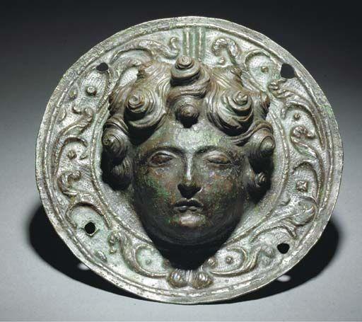 Roman shield boss umbo with a female head decoration.